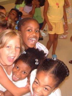 kids_in_school-June2002-hug-laughter-x350