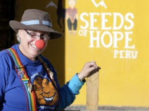 """Debra Hart with World Laughter Tour passing out 1000 Red Noses at """"Seeds of Hope"""" orphanage school; Huaraz; Peru"""